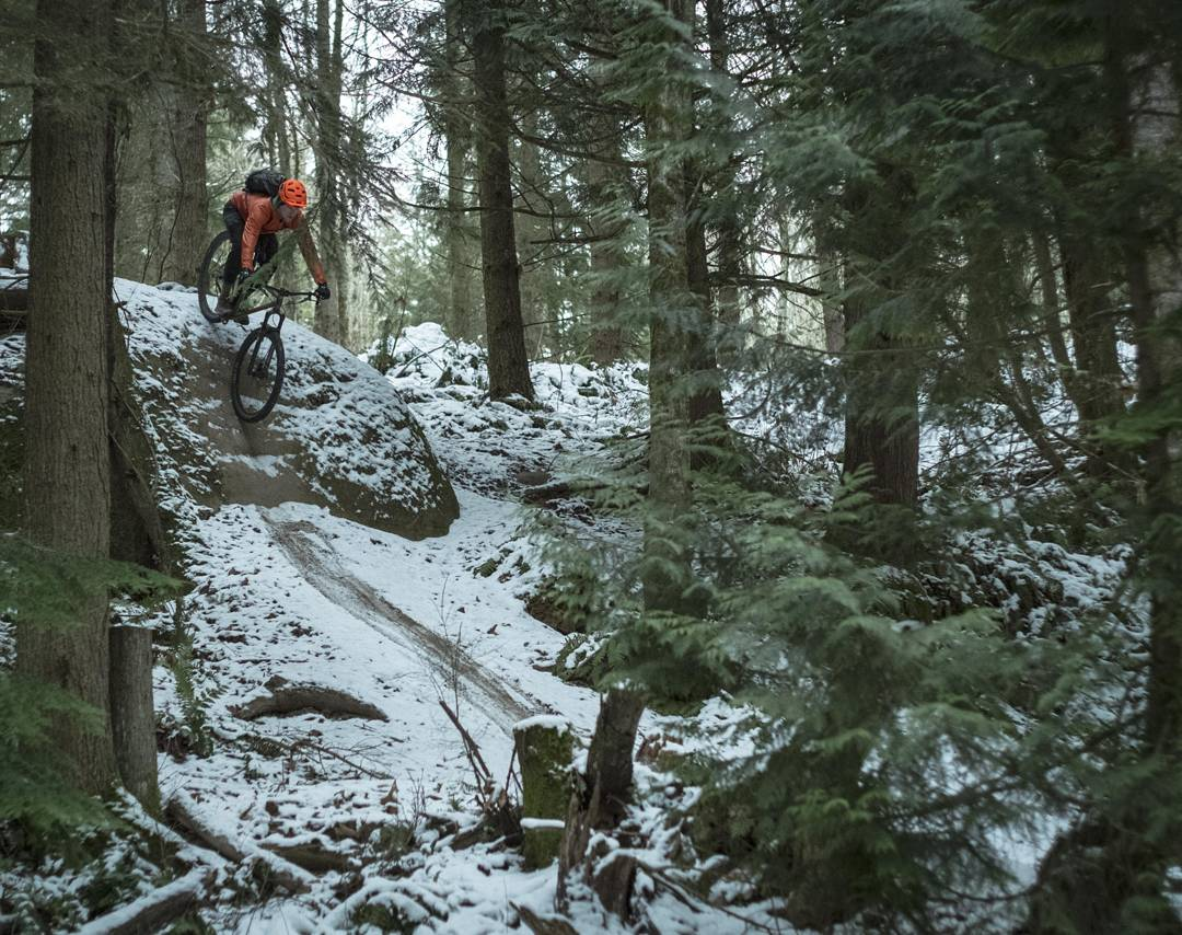 Rock roll on a mountain bike in the snow